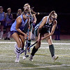 BRYAN EATON/Staff photo. Triton's Gianna Conte and Meg Freiermuth battle for control.