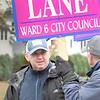 BRYAN EATON/Staff photo. Ward 6 city council candidate Byron J. Lane campaigns outside the senior center.