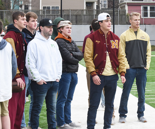 BRYAN EATON/Staff Photo. Newburyport High football alums watch the team at practice.