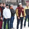 BRYAN EATON/Staff Photo. Newburyport High football alums watch the team at practice.