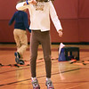 BRYAN EATON/Staff Photo. Aurelia Kostan, 7, keeps an eye on her wristband heart rate monitor while on a mini-trampoline, one of several excercise stations, during phyical education class at the Bresnahan School in Newburyport on Friday. They were learning about how the heart works and the stations produced different levels of heart rate which the monitors showed: blue for relaxation, yellow for stamina and endurance and red for high intensity.
