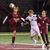 BRYAN EATON/Staff photo. Wayland's Christopher Nunn heads the ball as Henry Acton, left, and Russell Bleau cover.