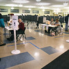 BRYAN EATON/Staff Photo. Voters started to trickle in as people got out of work and headed to Amesbury High School to cast ballots on Tuesday night.