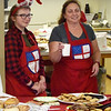BRYAN EATON/Staff photo. Gabriella Entrican, 12, of Amesbury, left, and Kelly Bennett of Newburyport served coffee and baked goods, among other food, at St. James Episcopal Church.