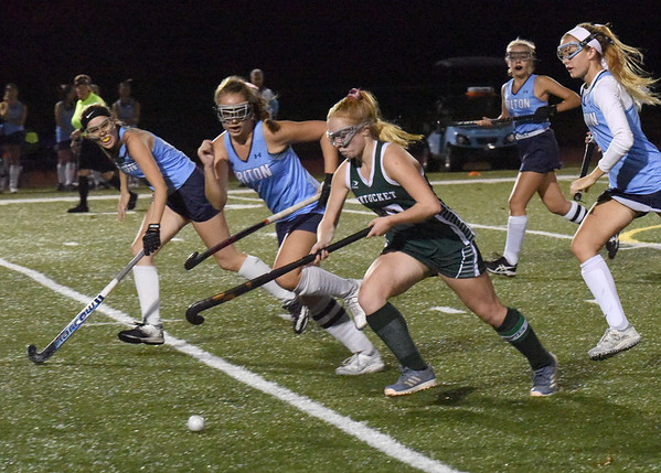 BRYAN EATON/Staff photo. Pentucket's Meghan Bean makes some ground as Triton defenders move in.