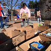 BRYAN EATON/Staff Photo. The Cashman School's fourth grade student council organized once again a Thanksgiving Food Drive which started just after Halloween. Monday was the day the Our Neighbors' Table sent the truck to be filled with the non-perishable items. Council members bring boxed of food to the curbside for pickup.