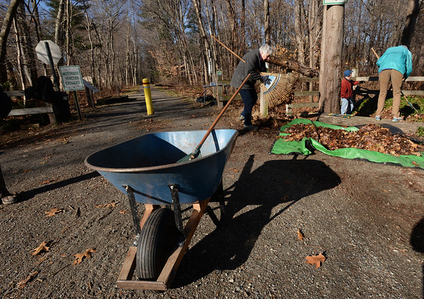 BRYAN EATON/Staff photo. Volunteers for the Coastal Trails Coalition fall cleanup spruce up the area at the intersection of the Ghost Trail and Bartlett Street in Salisbury on Saturday morning. Volunteers also were on the Marsh Trail and the Riverwalk Trail in Amesbury.