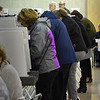 BRYAN EATON/Staff Photo. A sign in Amesbury High School cafeteria sets the tone as residents cast ballots on Tuesday night.
