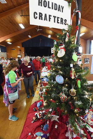 BRYAN EATON/Staff photo. There was something for everyone at the busy Holy Family Parish Hall during Amesbury's Village of Church Fairs on Saturday. Six churches participated in the over 20 year-old event where attendees can walk to each location in the downtown.