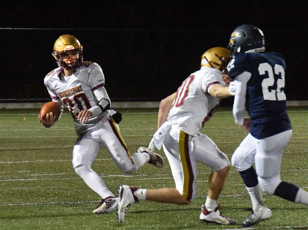 BRYAN EATON/Staff photo. Newburyport's Jacob Buontempo looks past the Lynnfield defense for an opening.