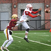 BRYAN EATON/Staff Photo. Amesbury's Drew MacDonald picks off a pass intended for Trevor Ward.