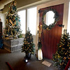 BRYAN EATON/Staff Photo. Gina Adamo of Newburyport created a replica of the door at Lowell's Boat Shop in Amesbury dressed seasonally at the Sea Festival of Trees.