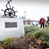 BRYAN EATON/Staff Photo. Members of the Newburyport Garden Club recently pulled dead and dying plants and raked the area around the Fishermen's Memorial on Newburyport's waterfront which will be replaced in the spring. The group will also be making the floral table arrangements for the Lions Club Thanksgiving Day dinner.