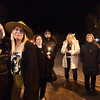 BRYAN EATON/Staff photo. An emotional Amanda Prescott, with hat, hugs Kathleen Fosher on Saturday night as her dog Vader was remembered by friends who walked to the downtown Newburyport shop holding candles and photos of Vader to give their support to Prescott. Her dog Vader, who was somewhat of a celebrity in the downtown, had to be euthanized as the canine family member had a brain tumor.