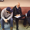 BRYAN EATON/Staff Photo. Amesbury Mayor Ken Gray writes down election results with his wife, Donna, left, Daniel Grayton, communications director; and Evan Kenney, chief of staff, right, back to camera.