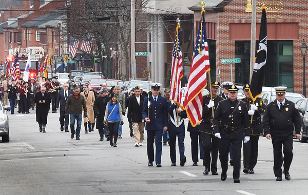 BRYAN EATON/Staff Photo. The Newburyport Veterans Day Parade heads up State Street to the Veterans Cemetery on Pond Street.