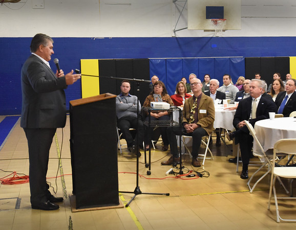 BRYAN EATON/Staff Photo. Former Boston Bruin player Ray Bourque speaks at the Boys and Girls Club Breakfast where he announced his family's foundation was contributing $30,000 to the club's capitall campaign. The meeting was held in the gymnasium, one of the areas that need improvement.