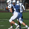 BRYAN EATON/Staff photo. Big Blue quarterback Graham Inzana hands off to Dylan January.