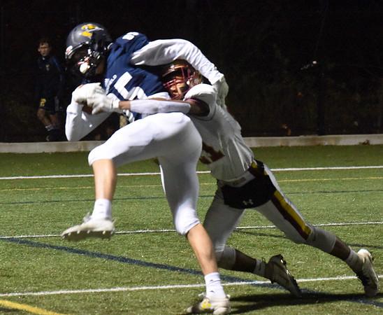 BRYAN EATON/Staff photo. Trevor Ward takes down Lynnfield receiver #15.