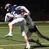 BRYAN EATON/Staff photo. Trevor Ward takes down Lynnfield receiver #15.