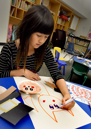 BRYAN EATON/Staff Photo. Stacia Larochelle, 8, creates a drawing of a fox after she and others created cut-outs of pilgrims at Salisbury Elementary School. She was at the afterschool program Explorations taking Color and Paint taught by Cindy Krafton.