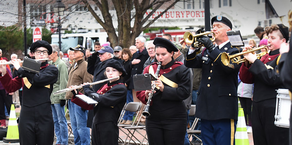 BRYAN EATON/Staff Photo. Members of the Newburyport High School Marching Band play the Star Spangled Banner in front of city hall.