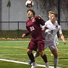 BRYAN EATON/Staff photo. Clipper's Daniel Bellerose heads the ball near Wayland's net.