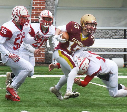 BRYAN EATON/Staff Photo. Newburyport's Tyler Foley gets some yardage as Amesbury moves in for the tackle.