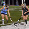BRYAN EATON/Staff photo. Triton's Rylee Lucia and Tess Beech move in for control of the ball.