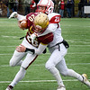 BRYAN EATON/Staff Photo. Jeremy Lopez tackles Newburyport's Jacob Buontempo.