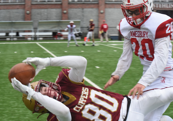 BRYAN EATON/Staff Photo. Nicholas Petty goes down with the catch as Amesbury's Brady Dore covers.