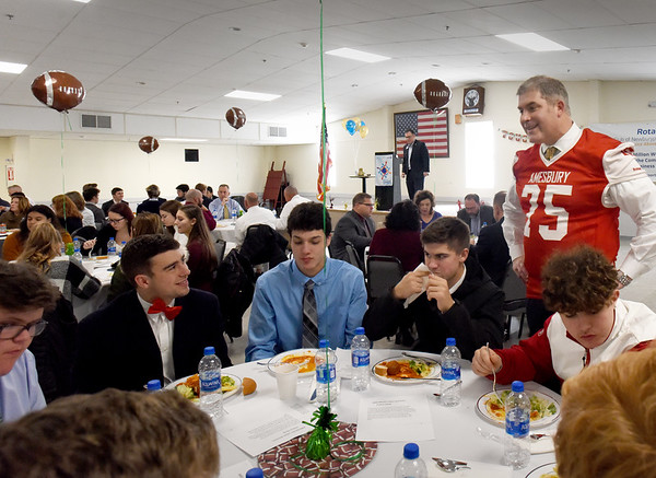 BRYAN EATON/Staff Photo. The Newburyport Rotary Club hosted a lunch for Newburyport and Amesbury High School football and cheerleading seniors at the Elks Lodge on Tuesday. State Rep. Jim Kelcourse, a member of the club and who played for Amesbury as a guard and defensive tackle, chats with this year's players.