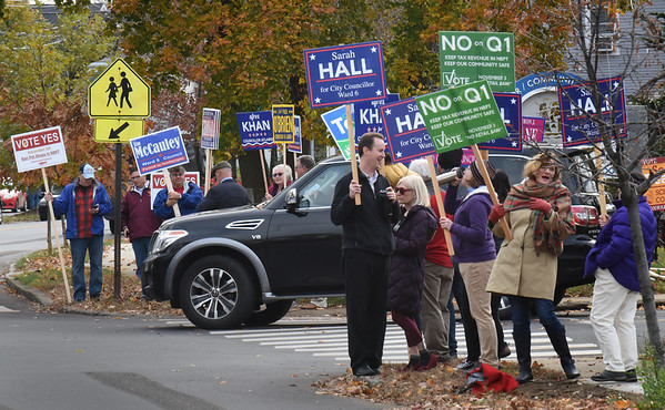 BRYAN EATON/Staff Photo. Newburyport city council and school committee candidates and their supporters greet residents as the head to vote at the Newburyport Senior and Community Center.