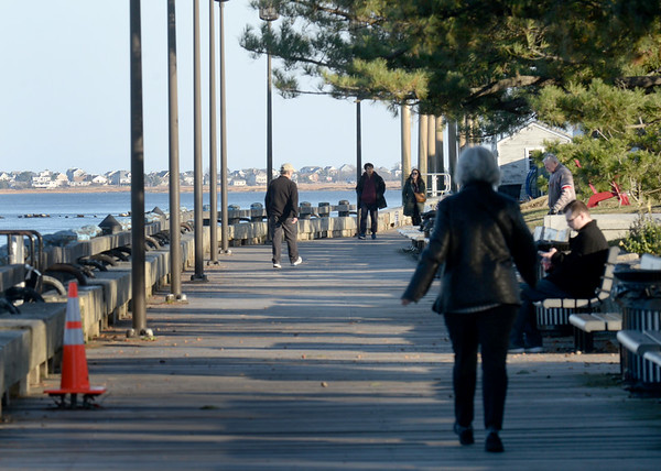 BRYAN EATON/Staff Photo. After a rainy and raw Sunday, the nice weather on Monday brought people out to Newburyport's boardwalk. The weather is still nice for Tuesday but rain is the forecast for Wednesday with clearing for Thanksgiving.