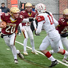 BRYAN EATON/Staff Photo. Newburyport's Jacob Buontempo stiff arms Kyle Donovan.