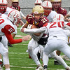 BRYAN EATON/Staff Photo. Amesbury defenders swarm Trevor Ward.