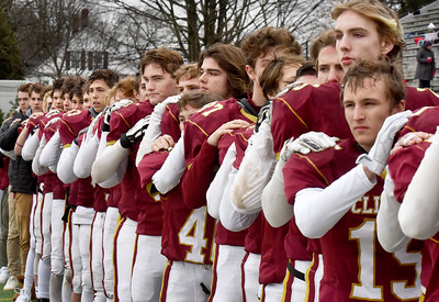 BRYAN EATON/Staff Photo. Players on the Newburyport High School football team listen to the playing of the Star Spangled Banner at the beginning of the Thanksgiving Day football game.