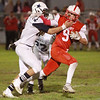 Hamilton-Wenham ian coffey tries to take down Amesbury ball carrier tucker molin Friday October 18, at Landry Stadium.<br /> Photo by Nicole Goodhue Boyd