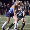 BRYAN EATON/Staff photo. Pentucket's Tess Beech tries to stop Triton's Brianna Hood's forward progress.