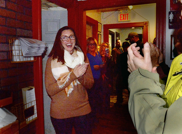 BRYAN EATON/Staff Photo. Amesbury mayor-elect Kassandra Gove is applauded as she enters Crave restaurant to greet her supporters Tuesday night.