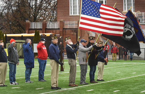 BRYAN EATON/Staff Photo. Members of the American Legion Post 2016 of Salisbury, Amesbury and Newburyport presented the colors for the playing of the Star Spangled Banner at the beginning of the Thanksgiving Day football game. Veterans who were in attendance were asked to join them if they wished.