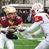 BRYAN EATON/Staff Photo. Kyle Donovan moves in to tackle Newburyport's Trevor Ward.
