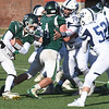 BRYAN EATON/Staff photo. Andrew Joyce looks for a way past the Swampscott defense.