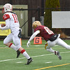BRYAN EATON/Staff Photo. Kyle Donovan runs in for a touchdown with Newburyport's Nicholas Petty in pursuit.