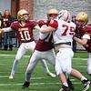 BRYAN EATON/Staff Photo. Newburyport quarterback Finn Sullivan looks for an open receiver.