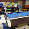 BRYAN EATON/Staff Photo. Youngsters play in the games room at the Boys and Girls Club before they meet for announcements, then go to different organized activities.