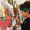 BRYAN EATON/Staff Photo. Third-graders in Pam Standley Jamison's art class at the Bresnahan School in Newburyport had the assignment to create turkey portraits incorporating their interests. Basketball fan Jamie Cuticchia, 8, wearing at Celtics headband created former Bulls' player Michael Jordan.