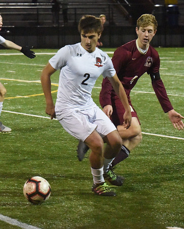 BRYAN EATON/Staff photo. Wayland's Ryan Najemy moves the keep the ball from Newburyport's Tyler Koglin from advancing it to his team's goal.