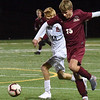 BRYAN EATON/Staff photo. Newburyport's Henry Acton moves to get the ball past Christopher Nunn.