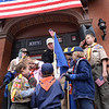 BRYAN EATON/Staff Photo. Veterans Agent Kevin Hunt is aided by several scout members during the Pledge of Allegiance.